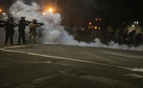 Federal law enforcement officers fire impact munitions and tear gas at protesters demonstrating against racism and police violence in front of the Mark O. Hatfield federal courthouse in Portland, Ore., on July 16, 2020. Through the end of 2020, the majori