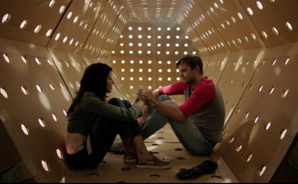 A Corrugated Community: Annie (Meera Rohit Kumbhani) and Dave (Nick Thune) in the Kubrick Corridor — an attraction of Dave's Maze.