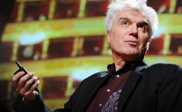 Musician David Byrne speaks from the TED stage.