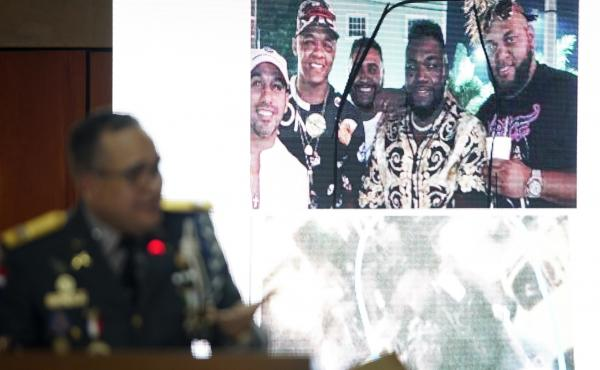 Ney Aldrin Bautista Almonte, director of the Dominican Republic's national police, projects a photograph of David Ortiz (second from right) taken on the night he was shot in Santo Domingo. Officials say a gunman shot Ortiz after mistaking him for Sixto Da