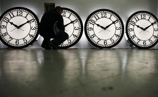 The U.S. moved back to Standard Time on Sunday. In this file photo, a man checks clocks at the Electric Time Company factory in Medfield, Mass.