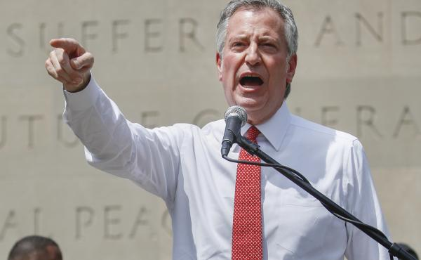New York City Mayor Bill de Blasio, shown here at an event last month, defended the move to shift funds away from the city's police department.