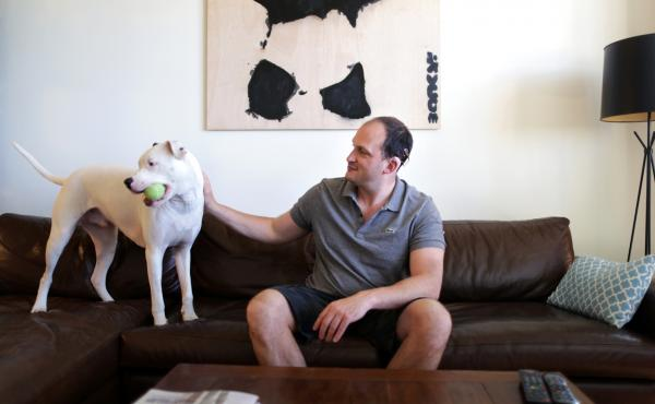 Sam Swiller and his dog, Sully, in their home in Washington, D.C.