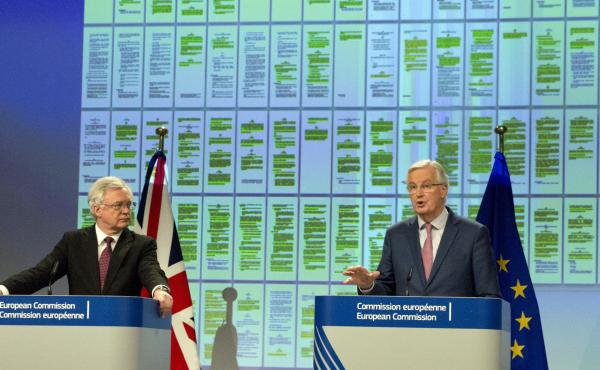 European Union chief Brexit negotiator Michel Barnier (right) and British Secretary of State for Exiting the European Union David Davis announced their progress Monday at EU headquarters in Brussels on Monday.