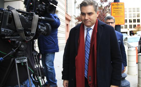 CNN's Jim Acosta walks into federal court in Washington, on Wednesday to attend a hearing on a legal challenge against the Trump administration.