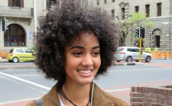 """Zia Simpson, a student and sales assistant in Cape Town, says even her father tells her to tame her Afro. """"That generation fought against apartheid, but they still carry around the mentality that green eyes look better on a person, that straight hair look"""