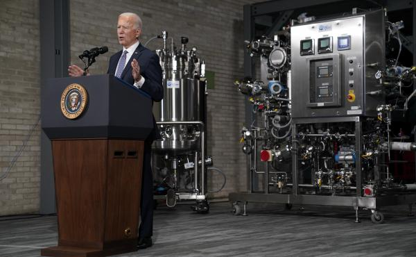 """In a February visit to Pfizer's Kalamazoo, Mich., manufacturing complex, President Biden said the administration had """"used the Defense Production Act to speed up the supply chain for ... key equipment, like fill pumps and filters, which has already helped"""