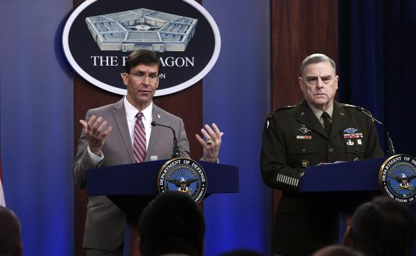 Defense Secretary Mark Esper (left) speaks as Chairman of the Joint Chiefs of Staff Army Gen. Mark Milley listens during a briefing at the Pentagon on Monday.