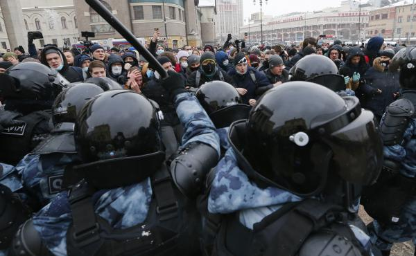 Demonstrators in Moscow clash with police Sunday during a protest against the jailing of Alexei Navalny. Thousands of people took to the streets across Russia to demand the opposition leader's release.