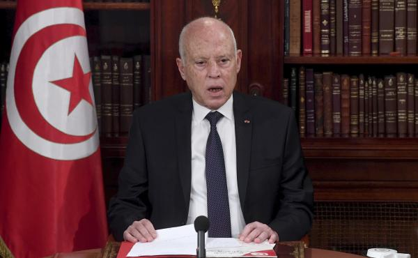 Tunisia's President Kais Saied leads a security meeting with members of the army and police forces in Tunis, Tunisia, on Sunday. Troops surrounded the parliament building and blocked its speaker Rached Ghannouchi from entering Monday after the president s