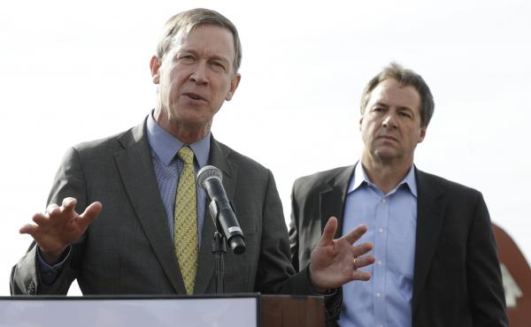 Then-Colorado Gov. John Hickenlooper (left) and Montana Gov. Steve Bullock at a 2016 Western Governors' Association meeting in Coronado, Calif. They are two Democrats considering running for president in 2020 with a message of pragmatism and bipartisan ac