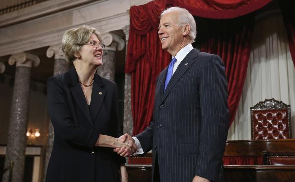 U.S. Sen. Elizabeth Warren participates in a re-enacted swearing-in with U.S. Vice President Joe Biden at the U.S. Capitol on Jan. 3, 2013.
