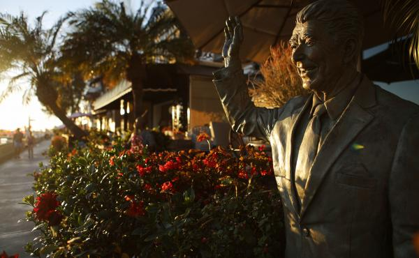 A statue of former President Ronald Reagan stands in front of a home on Orange County's Balboa Island. Reagan's political career and the Republican Party of the 1970s and '80s were long associated with Orange County, but the party was swept out of power t