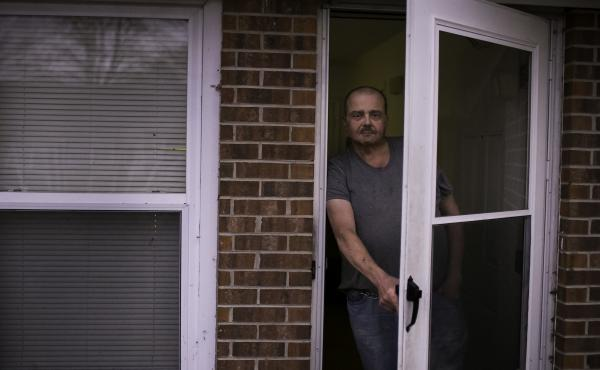 Stacy Holcomb, 57, stands in front of his home in Bladenboro, N.C., where he says he was approached by a woman during the midterm elections and offered assistance submitting an absentee ballot, an occurrence that many in Bladen County have said happened t