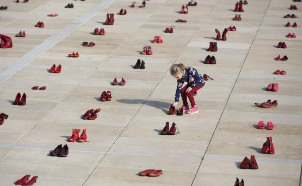 Hundreds of red shoes filled Tel Aviv's Habima Square on Tuesday, part of a nationwide protest to push the government to address violence against women.