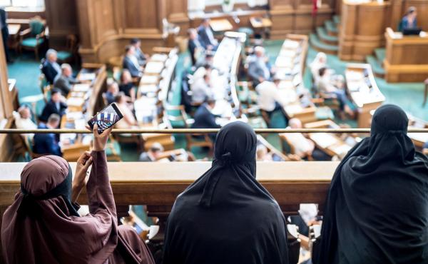 Women wearing the niqab sit in the audience at the Danish Parliament in Copenhagen on Thursday, as a bill that bans face coverings in public passes by a majority vote.