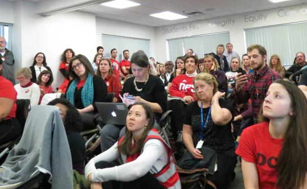 Denver Public School teachers gather in the district's bargaining room on Thursday, Jan. 17.