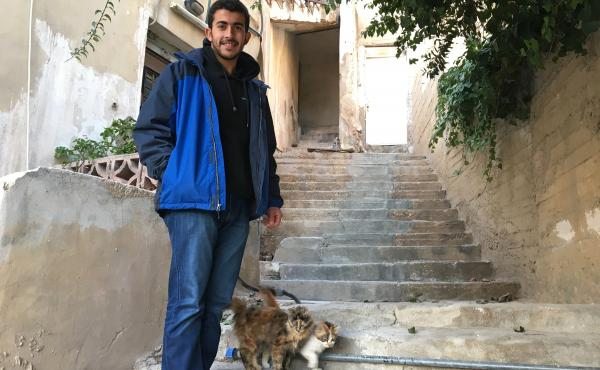 Yahya Abu Romman stands outside his family's home in downtown Amman. The 22-year-old was deported from the U.S. after landing in Chicago at the end of January with a valid visa. He says border officers questioned why he holds a Jordanian passport when he