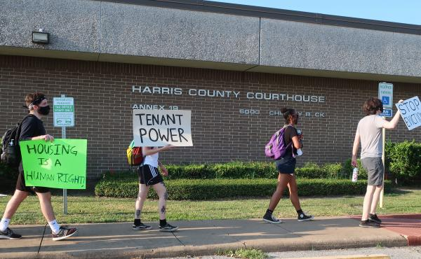 Protesters march Aug. 21 outside a courthouse in Houston, where evictions are continuing despite a moratorium ordered recently by the Centers for Disease Control and Prevention.