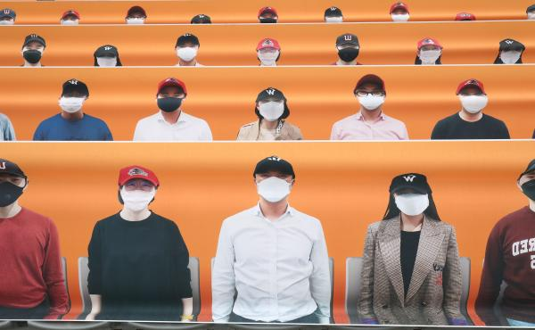 The stands at SK Wyverns club's Happy Dream Ballpark, are filled with placards featuring their fans during the Korean Baseball Organization (KBO) League opening game between SK Wyverns and Hanwha Eagles.