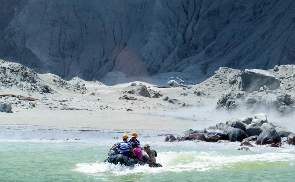 A rescue boat approaches New Zealand's White Island on Monday. A volcano on the island erupted, killing at least eight people.