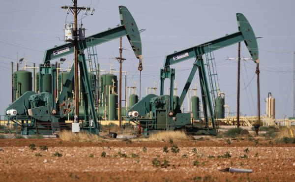 In this July 29, 2020 file photo, a view of a pump jack operating in an oil field in Midland, Texas.