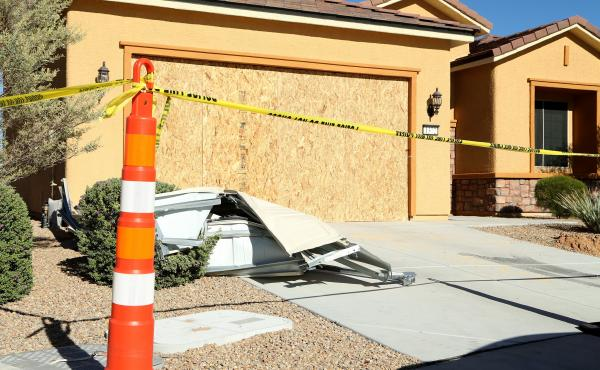 Remains of the garage door sit in the driveway at the house where Las Vegas gunman Stephen Paddock lived in the Sun City community in Mesquite, Nev.