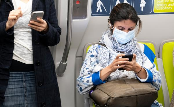 Health officials have identified what could be the first U.S. case of the novel coronavirus spreading within the general population. But a hospital says the diagnosis was delayed for days. Here, a passenger wears a face mask on a train in San Francisco on