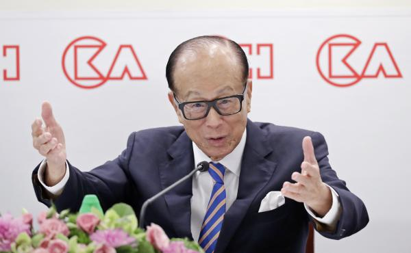Li Ka-shing speaks at a news conference in Hong Kong last year. The nonagenarian tycoon purchased full-page ads in local newspapers warning against violence — but at least one scholar of Chinese language sees a secret message of support for the proteste
