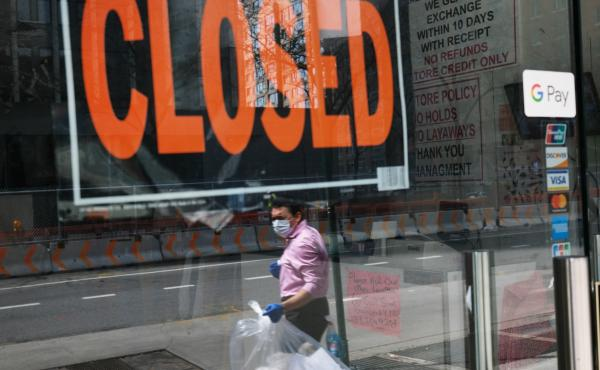 A closed sign is displayed in the window of a business in a nearly deserted lower Manhattan on April 17, 2020, in New York. Many small businesses benefited from a government emergency loan program during the pandemic, but its effectiveness is still in dou