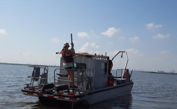 Lindsay Cristides, a master's student in oceanography at Texas A&M University, anchors a research vessel in the Houston Ship Channel before taking samples of sediment left behind by Hurricane Harvey floods. The samples will be tested for contaminants incl