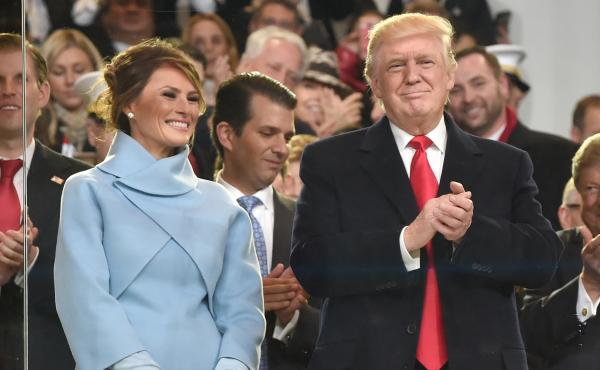 President Donald Trump; his wife, Melania, and other family members arrive for the presidential inaugural parade.