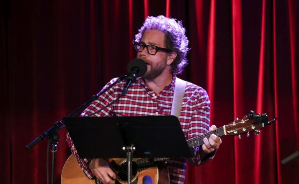 Ask Me Another house musician Jonathan Coulton leads a music parody game at the Bell House in Brooklyn, New York.