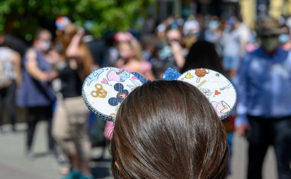 People visit Downtown Disney in Anaheim, California on July 9, 2020, the first day the outdoor shopping and dining complex was open to the public since closing in March amid the onset of the COVID-19 pandemic.