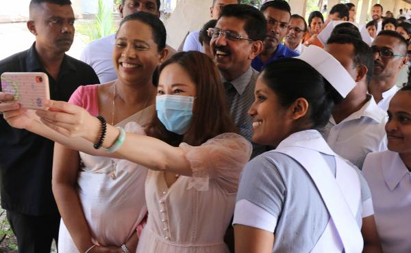 A recovered coronavirus patient takes a selfie before being discharged from a hospital in Sri Lanka. Researchers are trying to determine if having a case of COVID-19 will give you immunity.