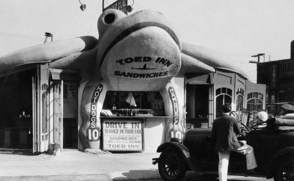 "This toad-shaped sandwich bar called the Toed In, near Los Angeles in 1939, allowed you to grab a bite to eat while your car got serviced. There's a lot of wordplay going on here: the toad-shaped building, the ""towing in"" of the car, and the stepping or """