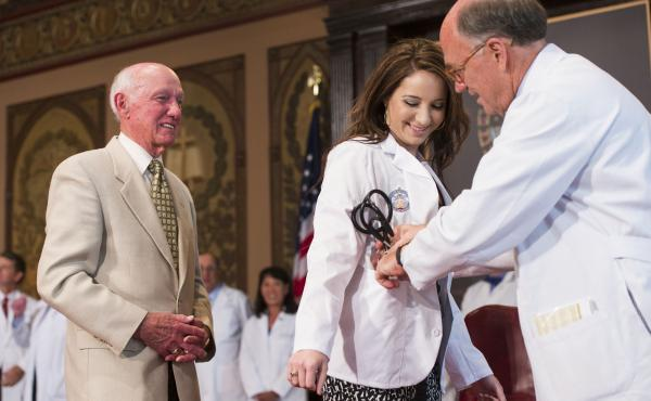 Victoria Elizabeth Fischer was presented with a white coat by her grandfather, Dr. Christian Van Den Heuvel, at Georgetown University School of Medicine in August. The ceremony marks the start for each new class of medical students.