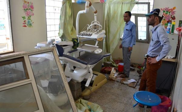 Yemenis inspect the damage in a room at a hospital operated by the Paris-based aid agency Doctors Without Borders in Abs, in the northern province of Hajjah, on Tuesday.