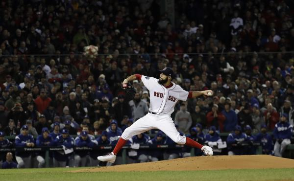 Boston Red Sox starting pitcher David Price winds up to throw Wednesday night during Game 2 of the World Series against the Los Angeles Dodgers at Fenway Park in Boston.