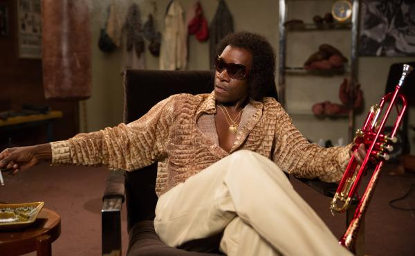 "Don Cheadle plays Miles Davis in the movie Miles Ahead. Cheadle's portrayal is being hailed as capturing the ""badass"" swagger that made Davis a hero to generations of black men."