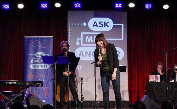 Ophira Eisenberg performs on stage alongside Jonathan Coulton on Ask Me Another at the Bell House in Brooklyn, New York.