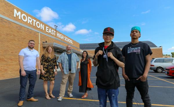 From left to right: Teachers Mark Sujak, Sarah Lorraine, Jeremy Robinson and Sophia Faridi pose with students and podcast finalists Julian Fausto and Eric Guadarrama for portraits in front of Morton East High School, in Cicero, Ill.
