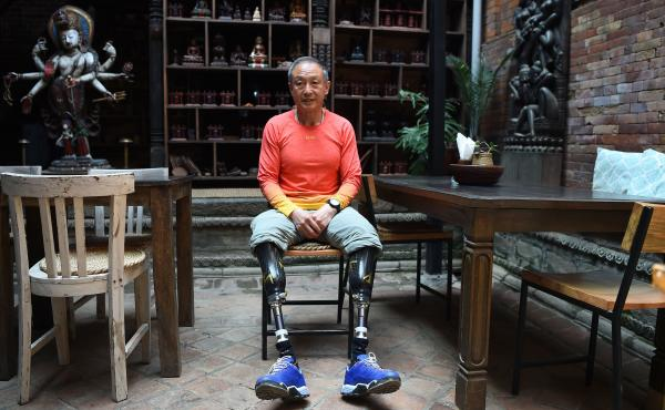 Xia Boyu, seen here on the outskirts of Kathmandu in early April, lost both his legs to frostbite on Mount Everest four decades ago. On Monday, he finally reached the mountain's summit.