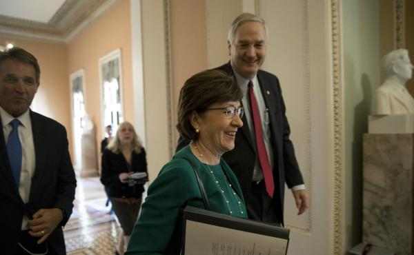 Sen. Susan Collins, a Republican from Maine, walks through the Capitol with colleagues in early December.