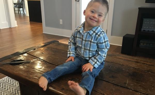 "Kelly Kuhns's 2-year-old son Oliver was born with Down syndrome. She says that she was shocked when a prenatal test revealed a Trisomy 21 mutation. But, she says, ""he's still a baby. He's still worthy of a life just like everybody else."""