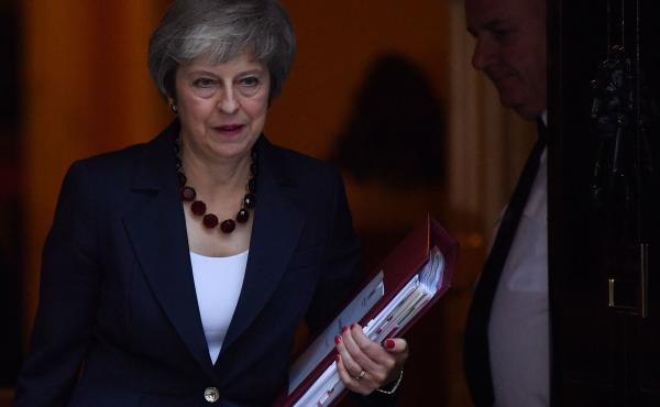 British Prime Minister Theresa May leaves No. 10 Downing Street in London on Wednesday. Now that May has reached an agreement with European Union negotiators, she faces still another difficult task: persuading skeptical Brits to get on board.