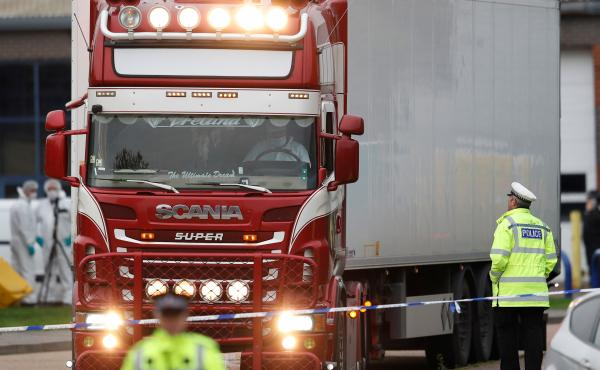 Police move a semitruck container where the bodies of 39 people were discovered in Grays, England, last week.