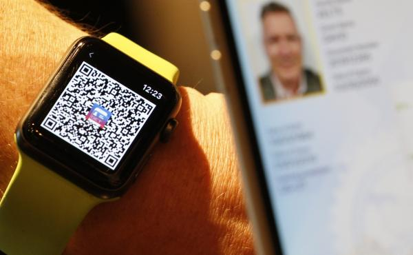 A person scans a QR Code on an Apple Watch to send a digital driver's license temporarily to another mobile phone last month in Salt Lake City. Utah is among eight states that eventually will let users add a license or state ID to Apple Wallet.