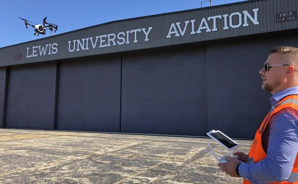 Jacob Reed, director of the Unmanned Aircraft Systems degree program at Lewis University, demonstrates a drone at the school's airfield outside of Chicago.