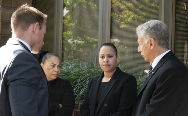 Rulennis Munoz (center right) outside Lancaster Courthouse Oct. 14, after learning that the police officer who fatally shot her brother had been cleared of criminal wrongdoing by the Lancaster County District Attorney. Her mother, Miguelina Peña, and her